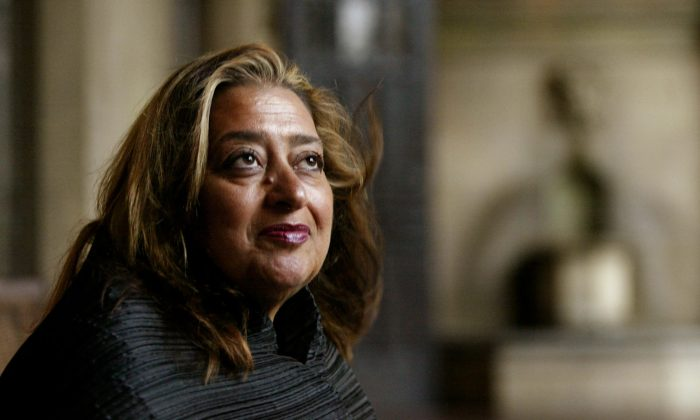 In this March 21, 2004 file picture, Iraqi-British architect Zaha Hadid poses in West Hollywood, Calif. Hadid, whose modernist, futuristic designs included the swooping aquatic center for the 2012 London Olympics, has died aged 65, Thursday, March 31, 2016. (AP Photo/Kevork Djansezian, File)
