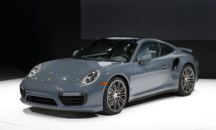 The Porsche 911 Turbo debuts at the North American International Auto Show in Detroit, Monday, Jan. 11, 2016. (AP Photo/Paul Sancya)
