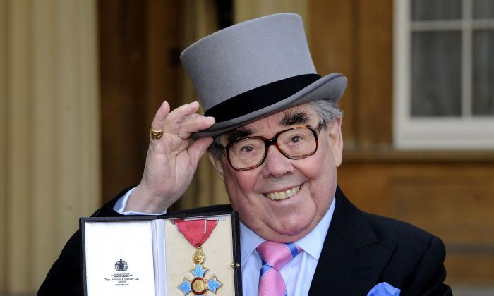 This is a Feb. 16, 2012 file photo of of British comedian Ronnie Corbett after he received his Commander of the British Empire (CBE), at Buckingham Palace in London. British comedian Ronnie Corbett, half of much-loved duo The Two Ronnies, has died at the age of 85. (Rebecca Naden/PA via AP)