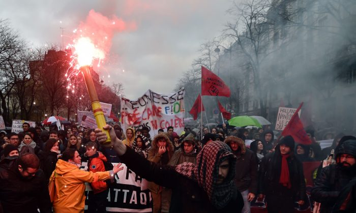 Protesters demonstrate during a demonstration against labour law reforms in the French capital Paris on March 31, 2016.  (Alain Jocard/AFP/Getty Images)