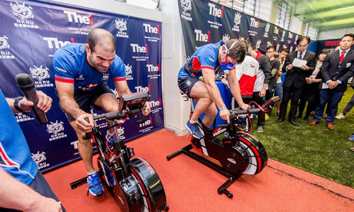 Thomas Lamboley (L) and Dan Falvey working their way through exercises involving sophisticated power bikes which measure performance from oxygen intake to power output per leg at the opening of the Elite Rugby Training Centre (ETRC) on Monday March 21, 2016. (HKRFU)