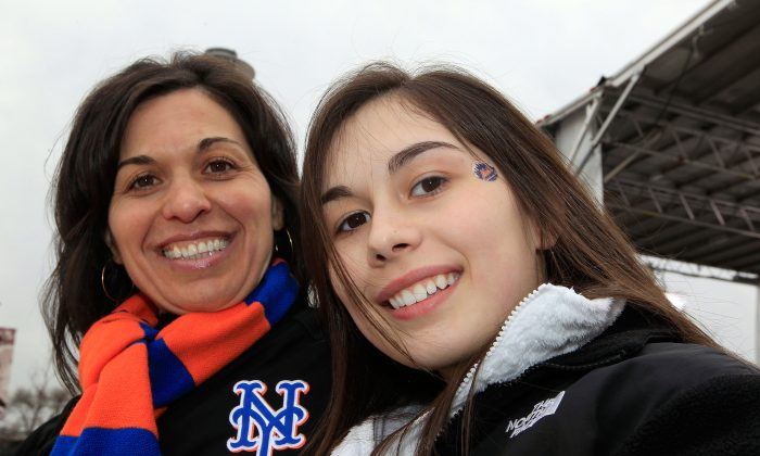 Rose (L) and Julia Wonsley, fans of the New York Mets support their team outside the staium prior to playing against the Washington Nationals during the Mets' Home Opener at Citi Field on April 8, 2011. (Chris Trotman/Getty Images)