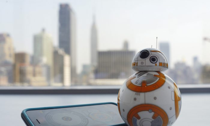 """This Thursday, Sept. 3, 2015 photo shows Sphero's BB-8 droid toy in New York. The BB-8 is controlled with a smartphone or tablet app and responds to basic voice commands such as """"wake up,"""" and """"look around."""" It's just under 5-inches tall and makes cute little Droid sounds reminiscent of R2-D2. (AP Photo/Patrick Sison)"""