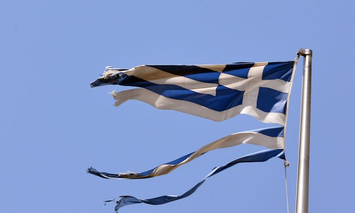 A ripped off Greek national flag flutters in central Athens on July 22, 2015. (Louisa Gouliamaki/AFP/Getty Images)