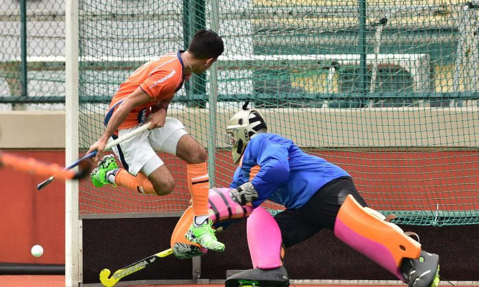 Khalsa captain Dev Dillon narrowly misses deflecting this ball towards the gaol. But SSSC keeper is well in position to defend in their final Premier division match of the 2015-16 season at HKFC on Sunday April 3. (Bill Cox/Epoch Times)