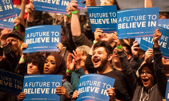 Supporters cheer as Democratic presidential candidate Sen. Bernie Sanders (D-VT) speaks during a political rally on April 5, 2016 in Laramie, Wyoming. Sanders spoke to a large crowd on the University of Wyoming campus after winning the Wisconsin primary. (Photo by Theo Stroomer/Getty Images)