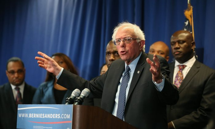 Democratic presidential candidate Sen. Bernie Sanders, (I-VT) speaks while flanked by African-American religious and civic leaders after a meeting at the Freddie Gray Youth Empowerment Center, December 8, 2015 in Baltimore, Maryland. Earlier in the day Sanders toured the Sandtown-Winchester neighborhood where Freddie Gray lived and was arrested.  (Photo by Mark Wilson/Getty Images)