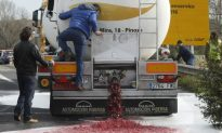 France Wages Wine-War on Spain; Dumps Roughly 90,000 Bottles of Spanish Wine Into Streets