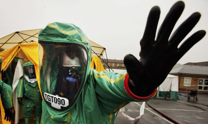 Emergency services exercise their abilitys in tackling a major contamination incident at Mayday hospital in Croydon, England, on April 23, 2006. The exercise involved decontamination units with representatives from ACHES (Association of Casualty and Health Emergency Simulators) playing the parts of the casualties. (Bruno Vincent/Getty Images)