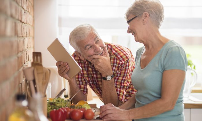 Modern senior couple spending time in the kitchen (iStock)