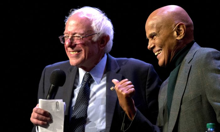 Democratic presidential candidate Sen. Bernie Sanders (I-Vt.) is joined on stage by Harry Belafonte as he speaks at a campaign event at the Apollo Theatre in the Harlem neighborhood of Manhattan on April 9, 2016. (AP Photo/Mary Altaffer)