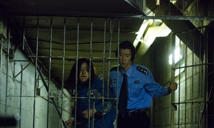 "A still from the film ""Bleeding Edge,"" shows Chen Jing, played by Anastasia Lin, imprisoned in China for her belief in Falun Gong. The film from Peabody Award-winning director Leon Lee premiers at the Palm Beach International Film Festival on April 11. (Courtesy of Floating Cloud Productions)"