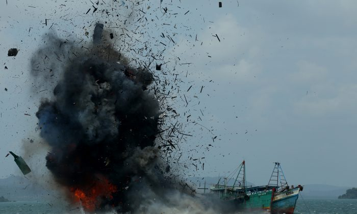 One of seven fishing boats is blown up by the Indonesian government in Batam, Kepulauan Riau province on Feb. 22, 2016. Indonesia destroyed 23 fishing boats after a recent maritime dispute with Chinese authorities. (Sei Ratifa/AFP/Getty Images)