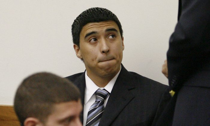 Esteban Nunez, center, son of former California Assembly Speaker Fabian Nunez, and Rafael Garcia, left, look on during a preliminary hearing on murder charges in Superior Court  Wednesday, March 18, 2009 in San Diego.  (AP Photo/Denis Poroy)