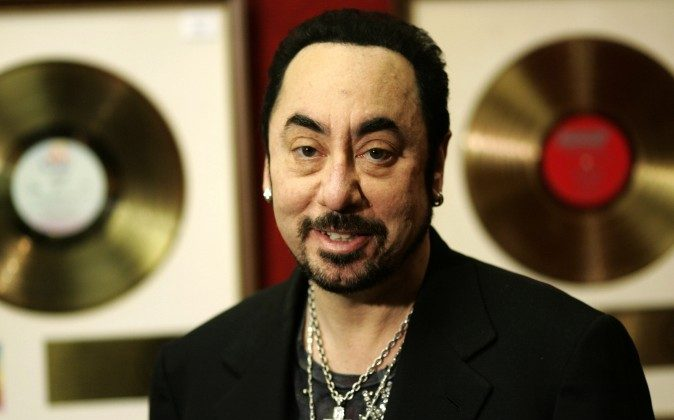 U.S. music producer David Gest poses with some of his collection of entertainment memorabilia at an auction house in London on Nov. 21, 2007. Music producer David Gest, ex-husband of Liza Minnelli, died Tuesday, April 12, 2016 at 62. (AP Photo/Sang Tan, file)
