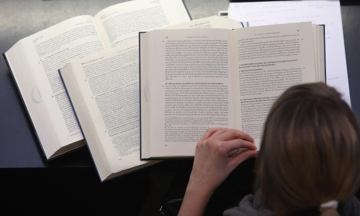A student studies legal textbooks in the law faculty at Humboldt University in Berlin, Germany, on Oct. 11, 2011. (Adam Berry/Getty Images)
