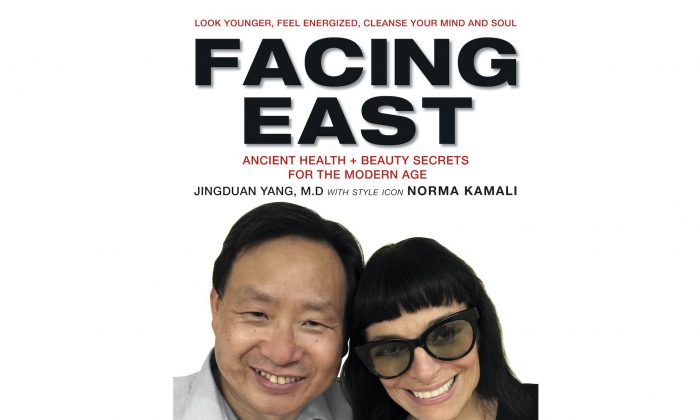"The book cover of ""Facing East"" by Jingduan Yang, M.D., F.AP.A. with style icon Norma Kamali. (Courtesy of Harper Collins Publishers)"