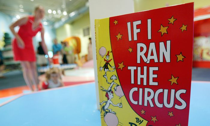 A Dr. Seuss book is seen as children play during a press preview of an interactive exhibition dedicated to Dr. Seuss at the Children's Museum of Manhattan July 6, 2004 in New York City. (Mario Tama/Getty Images)