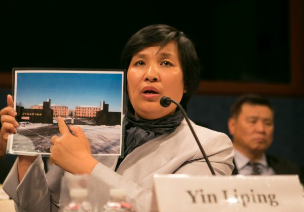 "Yin Liping testifies before the Congressional-Executive Commission on China, April 14, on ""China's Pervasive Use of Torture."" Ms. Yin is a Falun Gong practitioner who survived torture, forced labor, and sexual violence in Masanjia and other forced labor camps in China. (Lisa Fan/Epoch Times)"