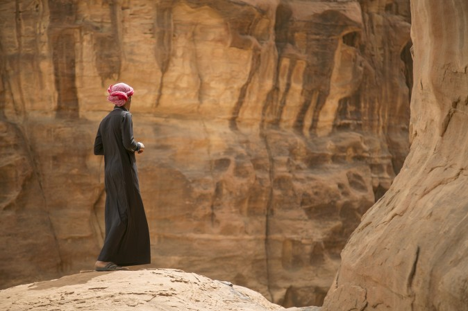 A Saudi man stands on the edge of a hill during a trip to the desert of Tabuk region, northwest of the capital Riyadh, on March 14, 2015. (Mohammed Albuhaisi/AFP/Getty Images)