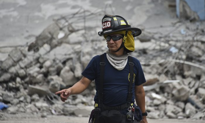 A rescue worker searches the rubble after a 7.8-magnitude quake in Guayaquil, Ecuador, on April 17, 2016. (Luis Acosta/AFP/Getty Images)