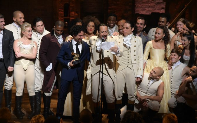 Music director Alex Lacamoire and Actor, composer Lin-Manuel Miranda celebrate on stage during 'Hamilton' GRAMMY performance for The 58th GRAMMY Awards at Richard Rodgers Theater on February 15, 2016 in New York City. (Photo by Theo Wargo/Getty Images)