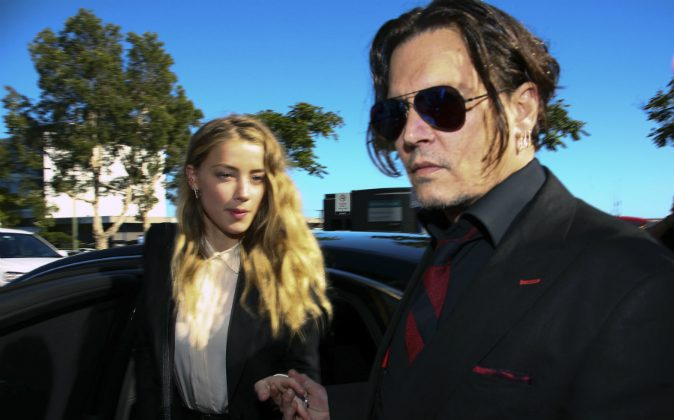 US actor Johnny Depp (R) and his wife Amber Heard arrive at a court in the Gold Coast on April 18, 2016. (PATRICK HAMILTON/AFP/Getty Images)