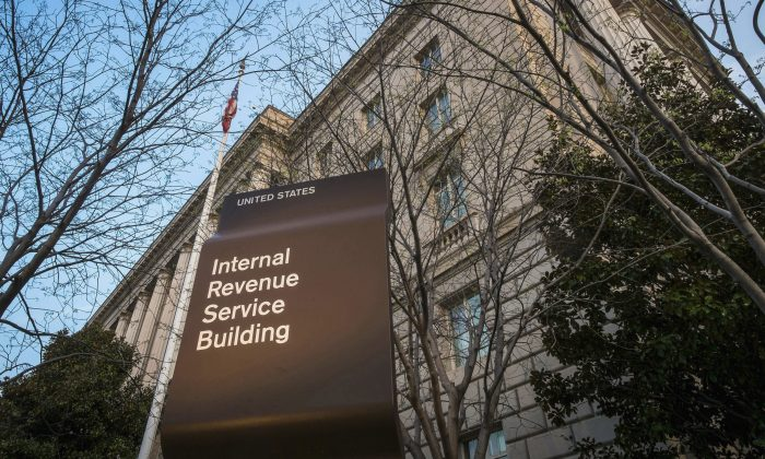This April 13, 2014, file photo shows the Internal Revenue Service (IRS) headquarters building in Washington. Millions of taxpayers face a midnight deadline Monday, March 18, 2016, to file their tax returns, while millions of other Americans seek more time, a six-month extension. The filing deadline was delayed three days beyond the traditional April 15 deadline, because Friday was a legal holiday in the District of Columbia.  (AP Photo/J. David Ake, File)