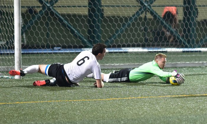GAS Goalie, Adam Bilbey, makes one of his important interceptions of the season in the match against Club Colts on April 3 helping his team to another important win in their journey to the 2015-16 league title. (Bill Cox/Epoch Times)
