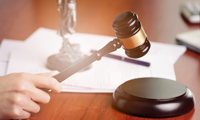 A judge holding a gavel in a stock image. (iStock)
