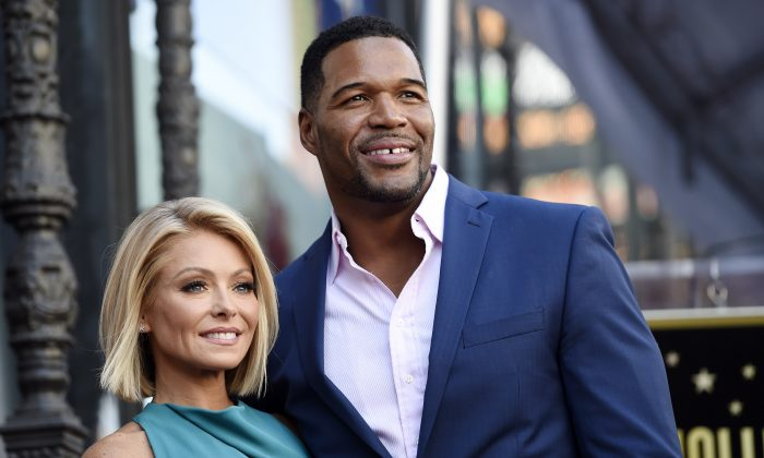 """In this Oct. 12, 2015 file photo, Kelly Ripa, left, poses with Michael Strahan, her co-host on the daily television talk show """"Live with Kelly and Michael,"""" during a ceremony honoring Ripa with a star on the Hollywood Walk of Fame in Los Angeles. (Photo by Chris Pizzello/Invision/AP, File)"""