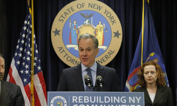 New York Attorney General Eric Schneiderman speaks at a news conference where he announced enforcement action against Morgan Stanley on February 11, 2016 in New York City.  (Photo by Eduardo Munoz Alvarez/Getty Images)