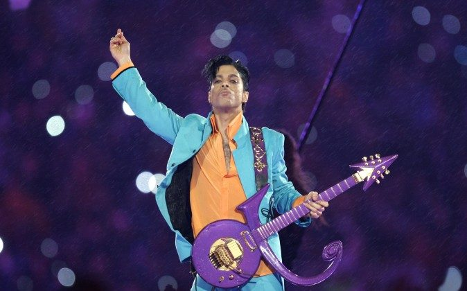 """In this Feb. 4, 2007 file photo, Prince performs during the halftime show at the Super Bowl XLI football game at Dolphin Stadium in Miami. Prince, widely acclaimed as one of the most inventive and influential musicians of his era with hits including """"Little Red Corvette,"""" ''Let's Go Crazy"""" and """"When Doves Cry,"""" was found dead at his home on Thursday, April 21, 2016, in suburban Minneapolis, according to his publicist. He was 57. (AP Photo/Chris O'Meara)"""