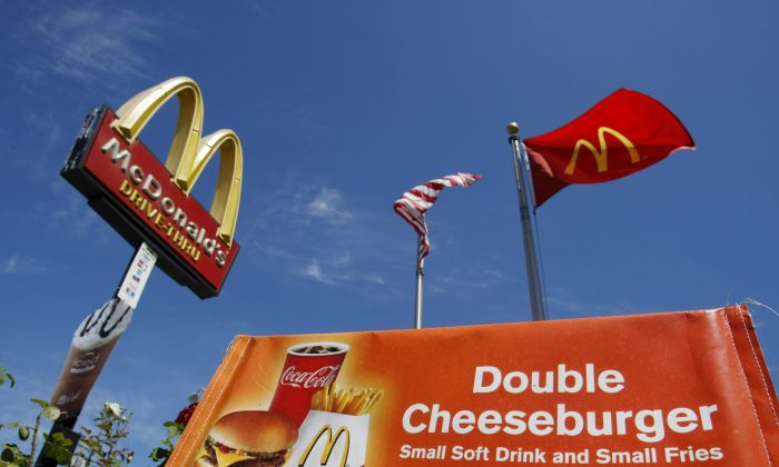 A Double Cheeseburger, Small Soft Drink and Small Fries meal is advertised at a McDonald's restaurant in San Jose, Calif., Wednesday, July 22, 2009. (AP Photo/Marcio Jose Sanchez)