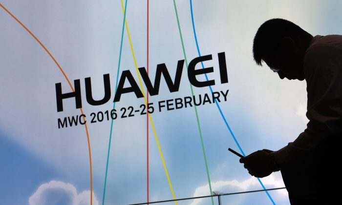 A sign for the Huawei booth at the Mobile World Congress in Barcelona, Spain on Feb. 22, 2016. (Luis Gene/AFP/Getty Images)