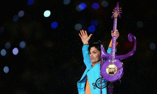 Minnesota Twins Baseball Team Honors Prince With Purple Lit Stadium