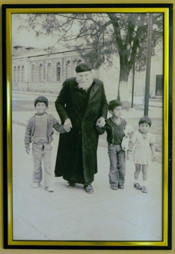 Father Crespi with some local children. (Crespi Museum in the Universidad Politécnica Salesiana)