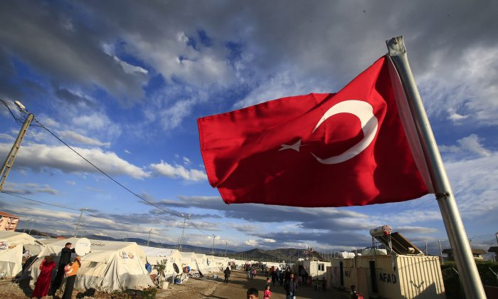 A Turkish flag flies at the refugee camp for Syrian refugees in Islahiye, Gaziantep Province, southeastern Turkey, on March 16, 2016. (AP Photo/Lefteris Pitarakis)