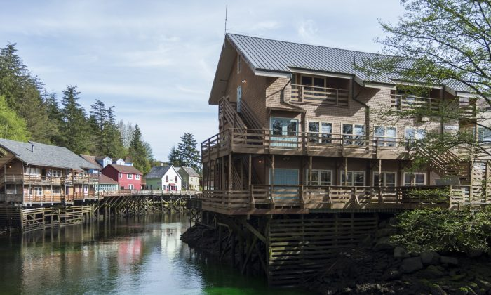 Green dye makes its way through Ketchikan Creek in Ketchikan, Alaska, on April 20, 2016. Authorities say the green water flowing in the Ketchikan Creek that caused some panic and drew a response from multiple agencies was the result of a prank. Officials have determined that the dye dumped into the water on Wednesday is non-toxic. Ketchikan police talked to the man responsible for the dye, but he was not arrested or cited. (Taylor Balkom/Ketchikan Daily News via AP)