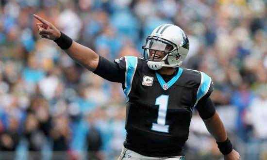 Cam Newton: Carolina Panthers Quarterback Hops Fence to Play Football With 7th Graders