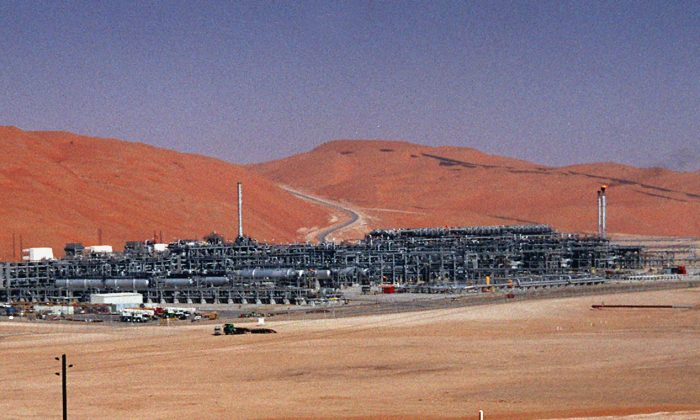 An industrial plant strips natural gas from freshly pumped crude oil is seen at Saudi Aramco's Shaybah oil field at Shaybah in Saudi Arabia's Rub al-Khali desert on March 8, 2004. (AP Photo/Bruce Stanley)