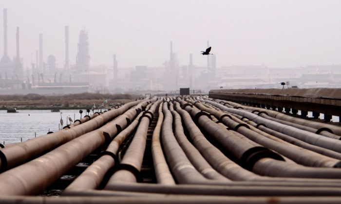 Oil pipelines on a hot, humid day near a refinery in Sitra, Bahrain, in the Persian Gulf, on Aug. 19, 2009. (AP Photo/Hasan Jamali)