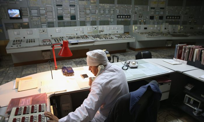 A worker makes a phone call in the control room of Reactor 2 inside the former Chernobyl nuclear power plant near Chernobyl, Ukraine, on Sept. 29, 2015. (Sean Gallup/Getty Images)