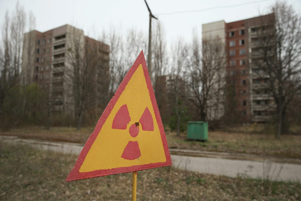 A sign warns of radiation contamination near former apartment buildings in Pripyat, near Chernobyl, Ukraine, on April 9, 2016. Pripyat, built in the 1970s as a model Soviet city to house the workers and families of the Chernobyl nuclear power plant, now stands abandoned inside the Chernobyl Exclusion Zone, a restricted zone contaminated by radiation from the 1986 meltdown of Reactor 4 at the nearby Chernobyl plant in the world's worst civilian nuclear accident that spewed radioactive fallout across the globe. Authorities evacuated approximately 43,000 people from Pripyat in the days following the disaster and the city, with its high-rise apartment buildings, hospital, shops, schools, restaurants, cultural center, and sports facilities, has remained a ghost-town ever since. Today, the world commemorates the 30th anniversary of the April 26, 1986 Chernobyl disaster. Today tour operators bring tourists in small groups to explore certain portions of the exclusion zone. (Sean Gallup/Getty Images)