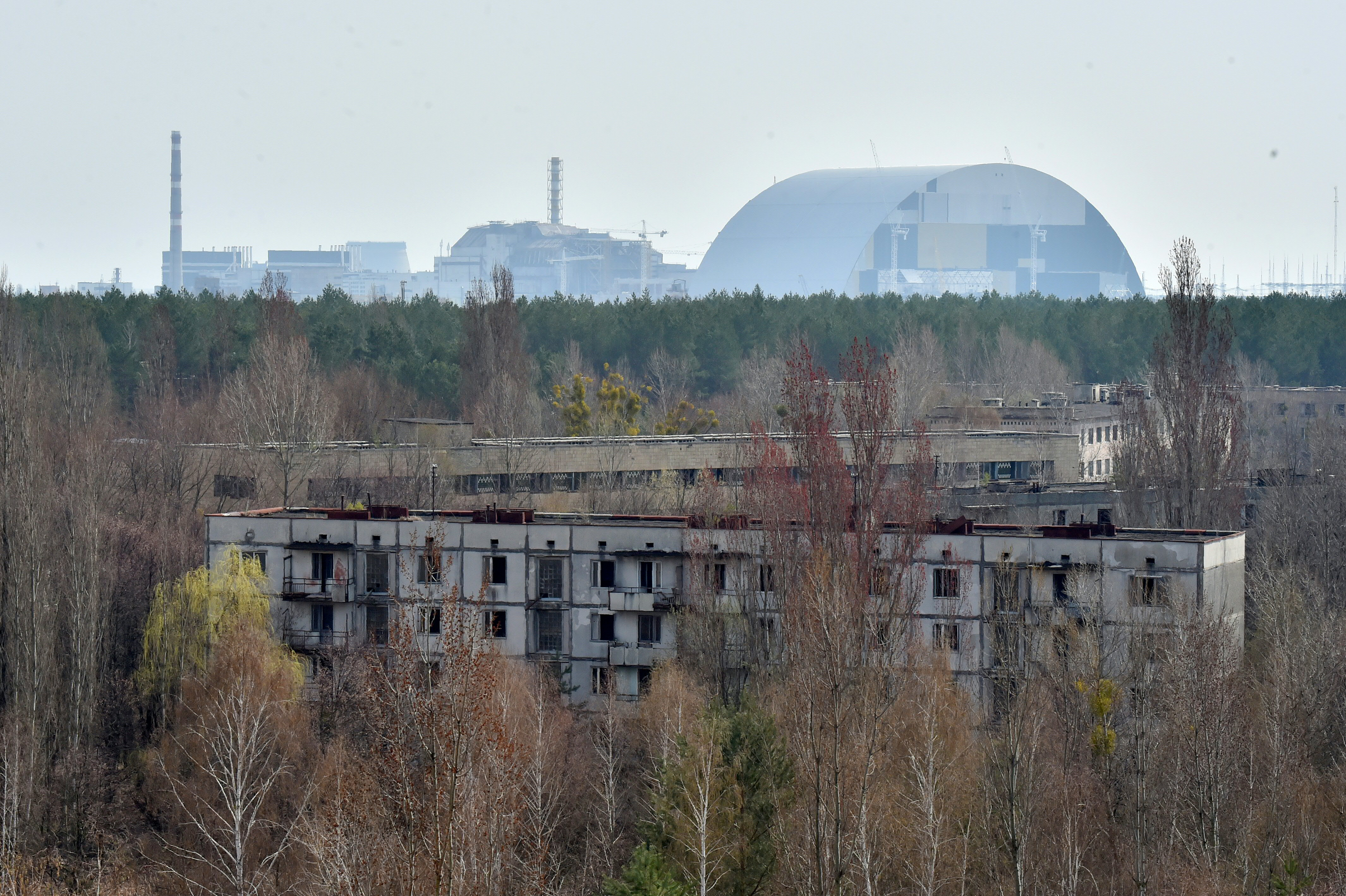 The picture shows a general view to Chernobyl Nuclear Power Plant from ghost city of Prypyat on April 8, 2016. (SERGEI SUPINSKY/AFP/Getty Images)
