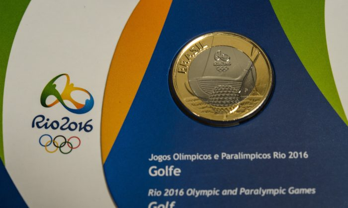 One real coin with a golf design from a set of the first edition of commemorative coins of the Rio 2016 Olympic and Paralimpic games is showed at the Central Bank of Brazil in Rio de Janeiro, Brazil. (Yasuyoshi Chiba/AFP/Getty Images)