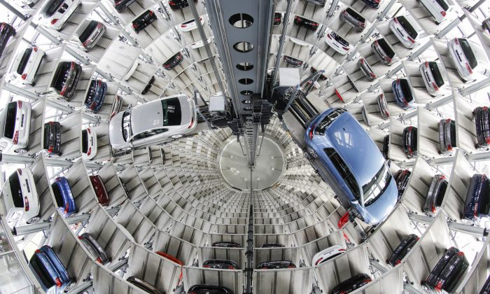 Volkswagen cars are presented to media inside a delivery tower prior to the company's annual press conference in Wolfburg, Germany, Thursday, April 28, 2016. (AP Photo/Markus Schreiber)