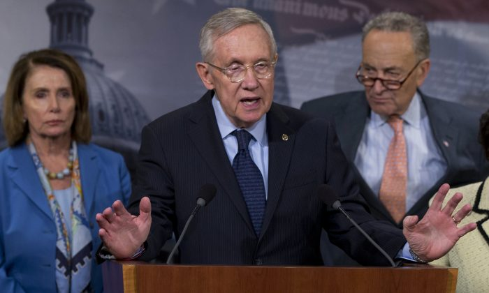 Then-Senate Minority Leader Sen. Harry Reid (D-Nev.), joined by House Leader Nancy Pelosi (D-Calif.), left and Sen. Charles Schumer, (D-N.Y.), in a file photo. (Carolyn Kaster/AP Photo)