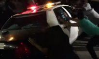 Anti-Trump Protesters Attack Cop Car Outside California Rally