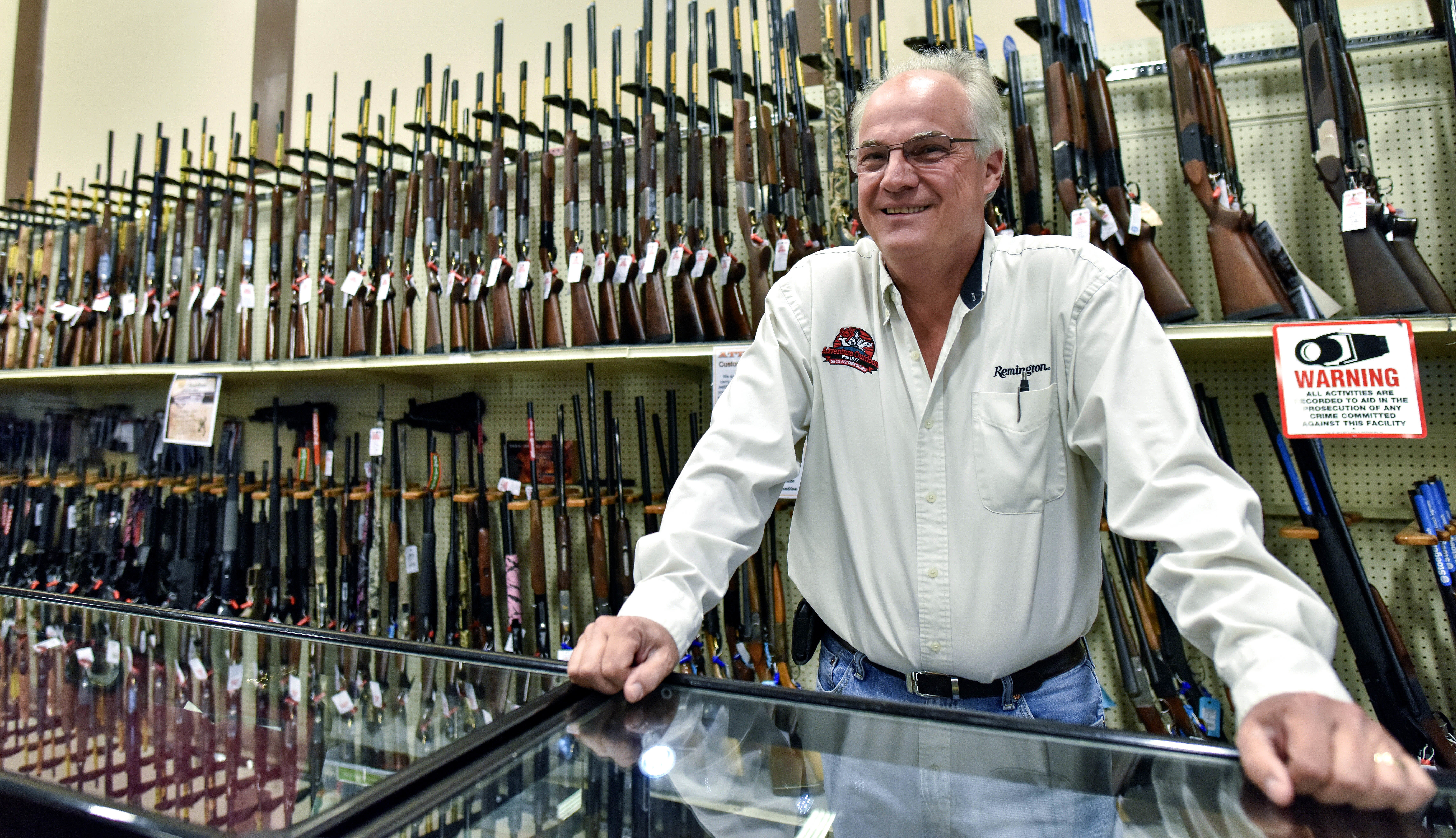 Jay Wallace, founder of Adventure Outdoors, poses for a portrait in Smyrna, Ga., on April 18, 2016. Wallace was among a group of gun dealers once sued by then-New York Mayor Michael Bloomberg over allegations of allowing illegal sales of firearms. (AP Photo/Lisa Marie Pane)